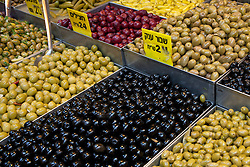 "Middle East, Israel, Jerusalem,  olives on display at Mahane Yehuda Market (also known as Machaneh Yehuda), often referred to as ""The Shuk"", is popular with locals and tourists alike, the market's more than 250 vendors sell fresh fruits and vegetables; baked goods; fish, meat and cheeses; nuts, seeds, and spices; wines and liquors; clothing and shoes; housewares, textiles, and even Judaica."
