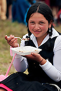 A GIRL HAVING HER LUNCH.