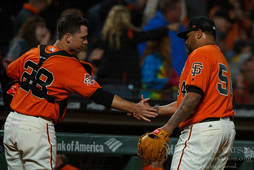 SAN FRANCISCO, CA - JULY 13: Reyes Moronta #54 of the San Francisco Giants celebrates with Buster Posey #28 during the seventh inning against the Oakland Athletics at AT&T Park on July 13, 2018 in San Francisco, California. The San Francisco Giants defeated the Oakland Athletics 7-1. (Photo by Jason O. Watson/Getty Images) *** Local Caption *** Reyes Moronta; Buster Posey