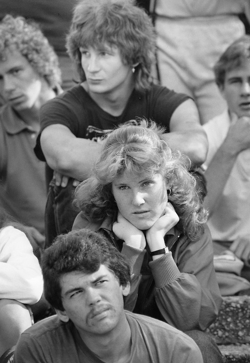©1989 college students listening to a Christian lecture on campus during the noon hour.
