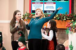 Cast members from the Winnipesaukee Playhouse perform a musical vignette to start the even session of the annual Children's Christmas Auction on Tuesday, December 4, 2012.  (Alan MacRae/for the Laconia Daily Sun)