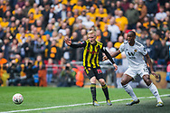 Will Hughes (Watford) & Willy Boly (Wolverhampton Wanderers) during the FA Cup semi-final match between Watford and Wolverhampton Wanderers at Wembley Stadium in London, England on 7 April 2019.