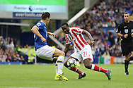 Gianelli Imbula of Stoke City (r) looks to go past Gareth Barry of Everton. Premier league match, Everton v Stoke city at Goodison Park in Liverpool, Merseyside on Saturday 27th August 2016.<br /> pic by Chris Stading, Andrew Orchard sports photography.