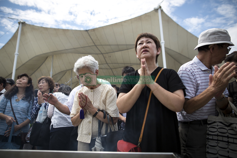 August 9, 2016 - Nagasaki, Nagasaki Prefecture, Japan - NAGASAKI, JAPAN - AUGUST 9 : Visitors pray for the atomic bomb victims in front of the Peace Statue during the 71st Anniversary of atomic bombing on Nagasaki at Nagasaki Peace Park, Nagasaki, southern Japan, Tuesday, August 9, 2016. Japan marked the 71st anniversary of the atomic bombing on Nagasaki. On August 9, 1945, during World War II, the United States dropped the second Atomic bomb on Nagasaki city, killing an estimated 40,000 people which ended World War II. (Credit Image: © Richard Atrero De Guzman/NurPhoto via ZUMA Press)