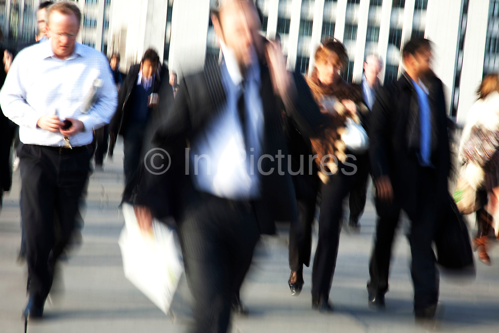Commuters and office workers cross London Bridge after work. This becomes a thoroughfare for those commuting out of London to the South each day.