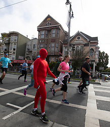 A man with a strategically placed wardrobe malfunction walks along Divisdero at the 107th running of the Bay to Breakers, Sunday, May 20, 2018, in San Francisco. (Photo by D. Ross Cameron)