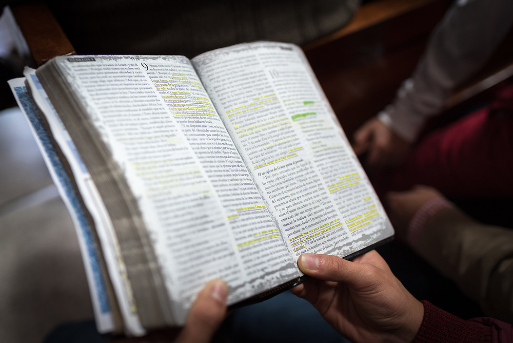 18 November 2018, Bogotá, Colombia: A congregant reads the Bible during Sunday service at the Church of San Lucas. The church of San Lucas ('Saint Lucas') of the Evangelical Lutheran Church of Colombia, brings together a congregation of some 100 people in the southern areas of Bogotá. Located in the Kennedy area, the church has recently celebrated 50 years. As part of its ministry, the church runs a school and college, The Colegio Evangelico Luterano de Colombia (CELCO) San Lucas, offering education to just over 1,000 students aged 3-18. The school started as a social initiative offering care for children aged 0-4 in Bogotá's less wealthy neighbourhood, allowing the parents opportunities to go to work. 36 years after its foundation, the school employs 56 staff, of which 36 are teachers.