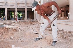 Construction worker in Havana working on the renovation of the Fine Art Museum  Museo de Bellas Artes,