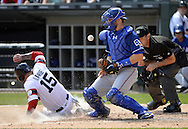 CHICAGO - APRIL 24:  Brett Nicholas #63 of the Texas Rangers can't catch the ball as Tyler Saladino #18 of the Chicago White Sox scores a run on April 24, 2016 at U.S. Cellular Field in Chicago, Illinois.  The White Sox defeated the Rangers 4-1.  (Photo by Ron Vesely)   Subject: Brett Nicholas; Tyler Saladino