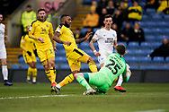 Conor O'Malley of Peterborough United makes a save as Jerome Sinclair of Oxford United lunges in for the ball during the EFL Sky Bet League 1 match between Oxford United and Peterborough United at the Kassam Stadium, Oxford, England on 16 February 2019.