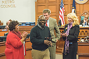 Journalist and author Michael L. Jones is honored with a Circle Team Award during a special meeting of the Louisville, Ky., Metro Council's Community Affairs Committee Thursday, Feb. 26, 2015, in the Council Chambers as part of its 13th Annual Black History Month Program. Councilwoman Barbara Shanklin (D-2) Chair of the committee, let, stood with Michael Jones, as Councilman Dan Johnson (D-21) presented the award with Councilwoman Angela Leet (D-7), right. (Photo by Brian Bohannon)
