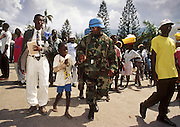 12 FEBRUARY 1996, PORT AU PRINCE, HAITI: US peacekeeping soldiers assigned to the UN mission in Haiti walk down a Port au Prince street with Haitian civilians, February, 1996.  PHOTO BY JACK KURTZ