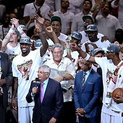 Jun 21, 2012; Miami, FL, USA; Miami Heat small forward LeBron James (6) along with teammates celebrate with the Larry O'Brien Trophy after winning the NBA championship in game five of the 2012 NBA Finals against the Oklahoma City Thunder at the American Airlines Arena. Miami won 121-106. Mandatory Credit: Derick E. Hingle-US PRESSWIRE