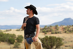 portrait of a sexy middle aged cowboy outdoors