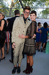 HENRY HOLLAND and PIXIE GELDOF at the Glamour Women of the Year Awards in association with Pandora held in Berkeley Square Gardens, London on 4th June 2013.