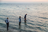 LESVOS, GREECE - FEBRUARY 09: Volunteers watch for the arrival of a dinghy where refugees are crossing the Aegean sea from the Turkish coast to a beach on the south of Lesvos on February 09, 2015 in Lesvos, Greece. Photo: © Omar Havana. All Rights Are Reserved