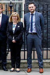 © Licensed to London News Pictures. FILE PIC 08/01/2018. London, UK. Prime Minister Theresa May poses Ben Bradley and Maria Caulfield on Downing Street following a cabinet reshuffle on Monday, 8 January 2018. Conservative party vice-chairs Ben Bradley and Maria Caulfield resigned form their positions yesterday over Theresa May's Brexit proposals. Photo credit: Tolga Akmen/LNP