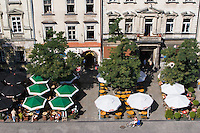 Cafes and Buildings on the main market square in Krakow Poland