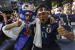 June 28, 2018 - Tokyo, Japan - Soccer fans pose for a photograph during a public viewing event in the Star Rise Tower (Tokyo Tower Media Center) to watch the FIFA World Cup Group H match between Poland and Japan, in Tokyo, Japan. Japan sealed their position to the second round of the FIFA World Cup despite losing to Poland 1-0 in Volgograd Arena in Volgograd, Russia. (Credit Image: © Rodrigo Reyes Marin/via ZUMA Wire via ZUMA Wire)