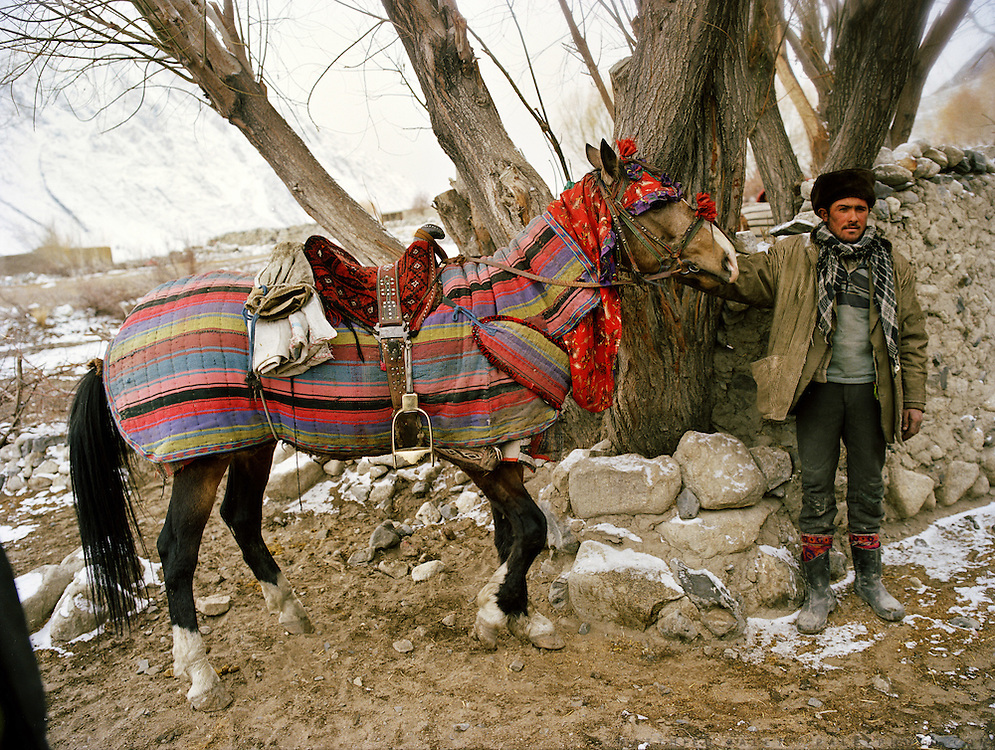 Invited party come by horse. Wedding celebration of Dodé Khuda, at Safar Boi house, in Tchehel-Kand village..Wakhi wedding ceremonies usually takes place in the winter months. The Wakhi do most of their business with Afghan Kyrgyz.