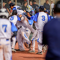 The Window Rock Scouts pile on Ethan Barton after an in-the-park home run on the Wingate Bears during the Wingate Baseball Slam tournament at Ford Canyon Park in Gallup Friday.