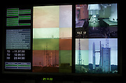 TV screens at Jupiter Control Center show launch readiness status of a European Space Agency's Ariane satellite rocket