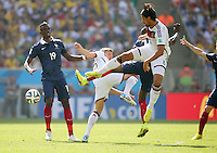 Sami Khedira of Germany battles for the ball as Paul Pogba of France looks