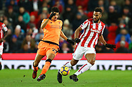 Eric Maxim Choupo-Moting of Stoke City passes the ball while under pressure from Dominic Solanke of Liverpool. Premier league match, Stoke City v Liverpool at the Bet365 Stadium in Stoke on Trent, Staffs on Wednesday 29th November 2017.<br /> pic by Chris Stading, Andrew Orchard sports photography.
