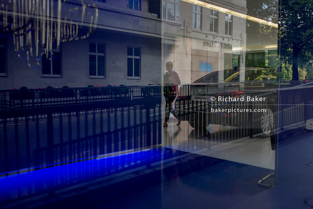 The BMW car showroom on Park Lane and reflections of the Mayfair street outside.
