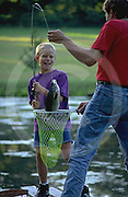 Outdoor recreation, Fishing, Father and Son Catch Bass Fish
