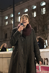 © London News Pictures. London, UK. 29/02/16. Caroline Lucas, MP for Brighton, speaks at a demonstration opposite Downing Street against the demolition of the 'Jungle' camp in Calais. French authorities have begun to evict the camp's residents, thought to number 5,500. . Photo credit: Rob Pinney/LNP