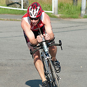 Male competitor in the bicycle leg of a triathlon in Wakefield, Massachusetts