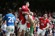 James Hook of Wales (c) celebrates his 2nd try as he is lifted by Lee Byrne. . RBS Six nations championship 2010, Wales v Italy at the Millennium Stadium in Cardiff  on Sat 20th March 2010. pic by Andrew Orchard, Andrew Orchard sports photography,