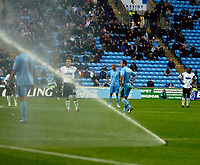 Photo: Ed Godden.<br />Coventry City v Derby County. Coca Cola Championship. 11/11/2006. The Pitch water sprinklers halt the game in the 2nd half after they accidently come on.