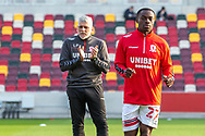 Middlesbrough players warming-up, Middlesbrough assistant coach Leo Percovich and Middlesbrough defender Marc Bola (27) before the EFL Sky Bet Championship match between Brentford and Middlesbrough at Brentford Community Stadium, Brentford, England on 7 November 2020.
