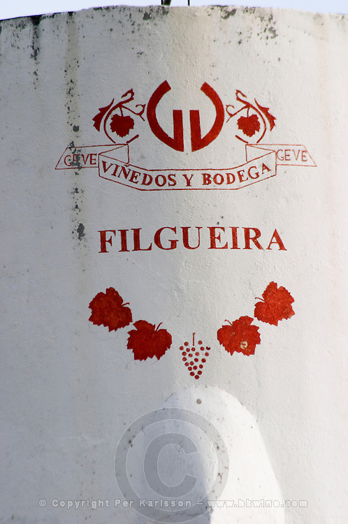 On the water tower tank: the name of the winery painted in red on white. Vinedos y Bodega Filgueira Winery, Cuchilla Verde, Canelones, Montevideo, Uruguay, South America