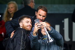 England Manager Gareth Southgate poses for a selfie with fans at Fulham- Mandatory by-line: Robbie Stephenson/JMP - 26/08/2018 - FOOTBALL - Craven Cottage - Fulham, England - Fulham v Burnley - Premier League
