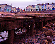 A colour Image of the Promenade on Llandudno Beach, Llandudno, North Wales. This shot shows the long empty beaches of the North Wales coast during the quiet winter season. I chose this shot as I love the way the houses behind add some real colour to the image to show the life hiding away for the winter. <br /> <br /> This image is ready to download for personal or commercial use and to order as a limited edition print. I will only make available 50 prints of this image, you can choose to have it printed on canvas or as a framed or unframed print ensuring you have an exclusive peace of highly collectable photo art to add to any home or business.