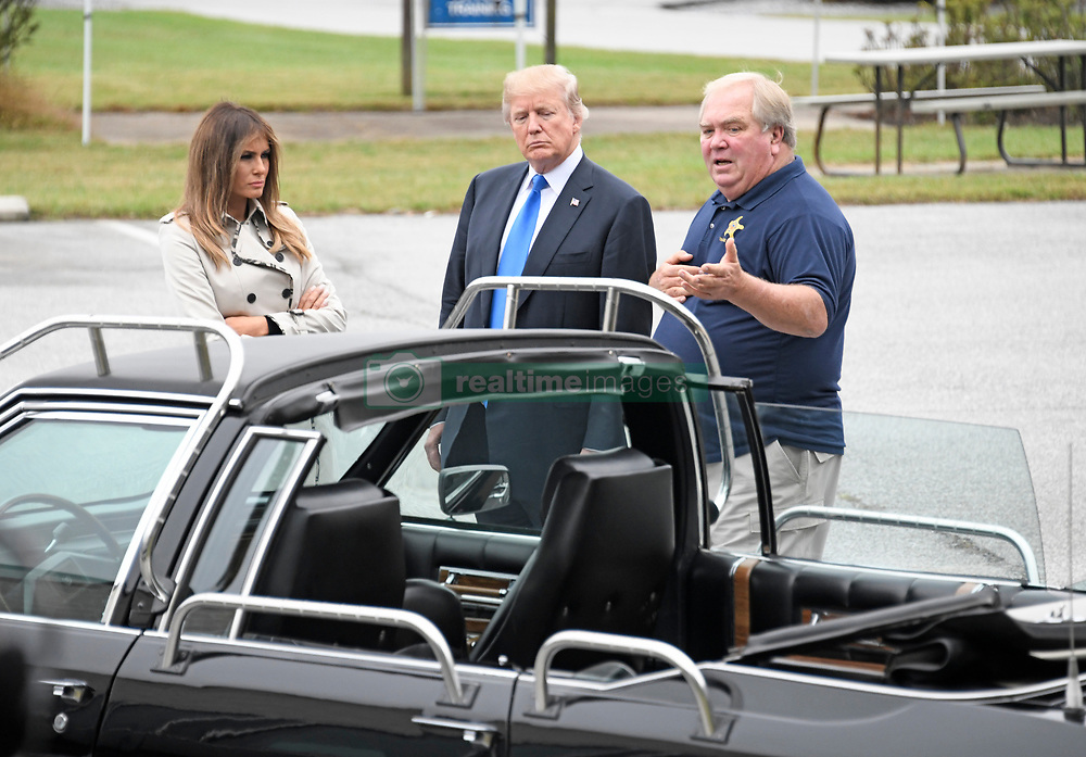 An unidentified United States Secret Service agent speaks with US President Donald J. Trump and first lady Melania Trump as they tour the US Secret Service James J. Rowley Training Center in Beltsville, Maryland on Friday, October 13, 2017.  In the foreground is the car that was used to evacuate then-US President Ronald Reagan from a golf course in Augusta, Georgia on October 22, 1983 when an armed man crashed through the gate of the golf course and demanded to speak to the President.  <br /> (Photo by Ron Sachs/CNP/Sipa USA)