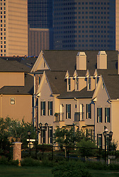 Stock photo of a group of townhomes along the edge of downtown Houston