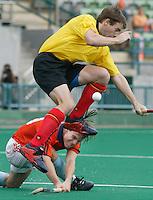 WK Hockey. Nederland-Belgie (5-1). Matthijs Brouwer ziet zijn schot gestopt door de Belg Gilles Petre.