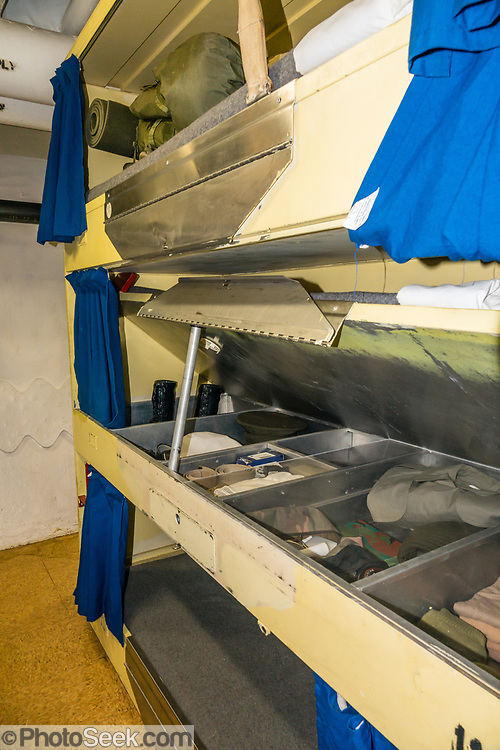 """Bunks in crew quarters of 1944 USS Missouri, Pearl Harbor, Oahu, Hawaii, USA. Ordered in 1940 and active in June 1944, the USS Missouri (""""Mighty Mo"""") was the last battleship commissioned by the United States. She is best remembered as the site of the surrender of the Empire of Japan which ended World War II on September 2, 1945 in Tokyo Bay. In the Pacific Theater of World War II, she fought in the battles of Iwo Jima and Okinawa and shelled the Japanese home islands. She fought in the Korean War from 1950 to 1953. Decommissioned in 1955 into the United States Navy reserve fleets (the """"Mothball Fleet""""), she was reactivated and modernized in 1984 and provided fire support during Operation Desert Storm in January-February 1991. The ship was decommissioned in March 1992. In 1998, she was donated to the USS Missouri Memorial Association and became a museum at Pearl Harbor, on the island of Oahu, Hawaii, USA."""
