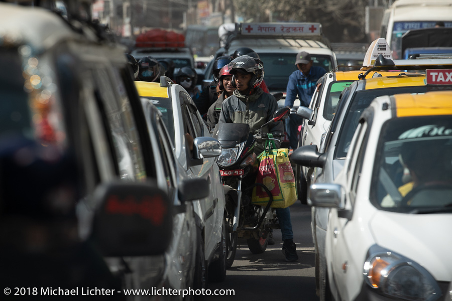 Riding a motorcycle on the streets of Kathmandu during ourHimalayan Heroes adventure, Nepal. Monday, November 5, 2018. Photography ©2018 Michael Lichter.