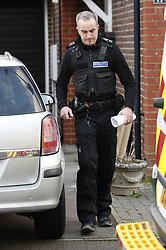© Licensed to London News Pictures. 22/12/2018. Crawley, UK. Police are seen outside a property in Crawley. Is is not clear if this is in connection to the couple detained by police over the Gatwick drone attacks. Photo credit: Peter Macdiarmid/LNP