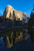 "El Capitan, a 7,573-foot (2,308 meter) granite peak is reflected in the Merced River as it flows through Yosemite National Park, California. El Capitan is one of the most prominent peaks in the Yosemite Valley and its name is the Spanish word for ""captain,"" an homage to its Native American name, which meant ""chief."""