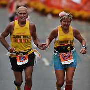 The Finish Line. Expressions of agony and ecstasy on the faces of athletes as Troy Johnson  and Cathie Johnson, Red Boiling Springs, finish the ING Hartford Marathon, Bushnell Park, Hartford. Connecticut. USA. Hartford, Connecticut, USA. 12th October 2013. Photo Tim Clayton