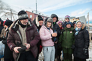 Friends pose for a picture, gathered to celebrate SolFest in Longyearbyen, Svalbard. The festival marks the official arrival of the sun to the town – by tradition, to the old hospital steps (sykehustrappa).