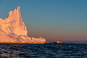 The expedition vessel MS Polar Pioneer and a giant iceberg at Hydruga Rocks, the Palmer Archipelago, the Antarctica.