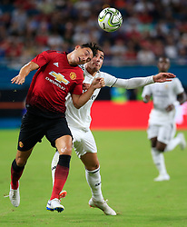 July 31, 2018 - Miami Gardens, FL, USA - Manchester United defender Matteo Darmian (36) and Real Madrid defender Theo Hernandez (15) battle for the ball in the first half at Hard Rock Stadium in Miami Gardens, Fla., on Tuesday, July 31, 2018. Manchester United won, 2-1. (Credit Image: © Al Diaz/TNS via ZUMA Wire)