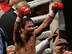 Jan 19,2019. Las Vegas NV.( in blk trunks)  Manny Pacquiao waves to his fans as he takes the win after going 12 rounds with Adrien Broner at the MGM grand Hotel Saturday. Manny Pacquiao  took the win by unanimous decision for the World Welterweight Championship..Photo by Gene Blevins/Contributing Photographer. (Credit Image: © Gene Blevins/ZUMA Wire)